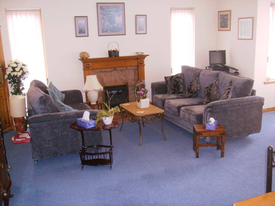 residents lounge area. large comfortable sofas, and welcoming real flame fire