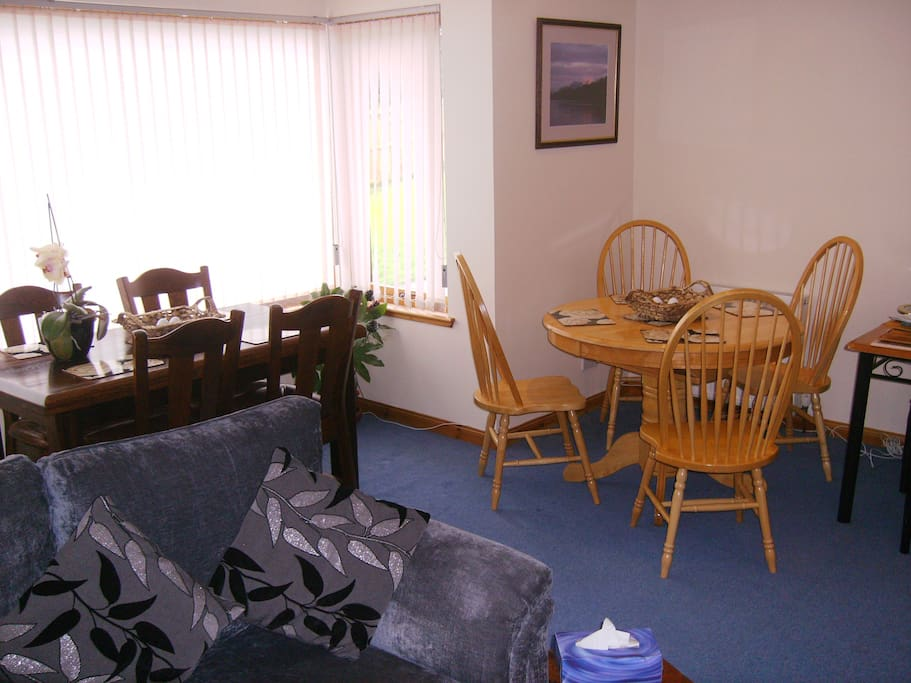 resident dining area with bay window looking out to the Moray Firth