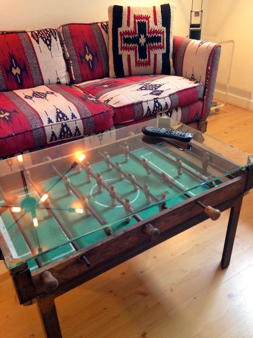 An antique foosball table for a coffee table.