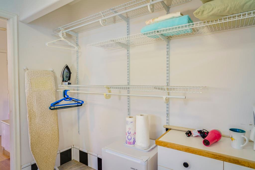 Storage space for clothes, iron and ironing board and a mini fridge for your refreshments.