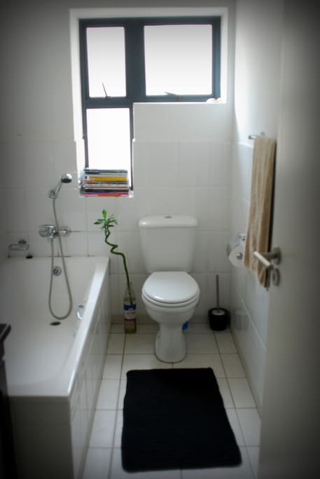 Bathroom with bath and sink and hand shower