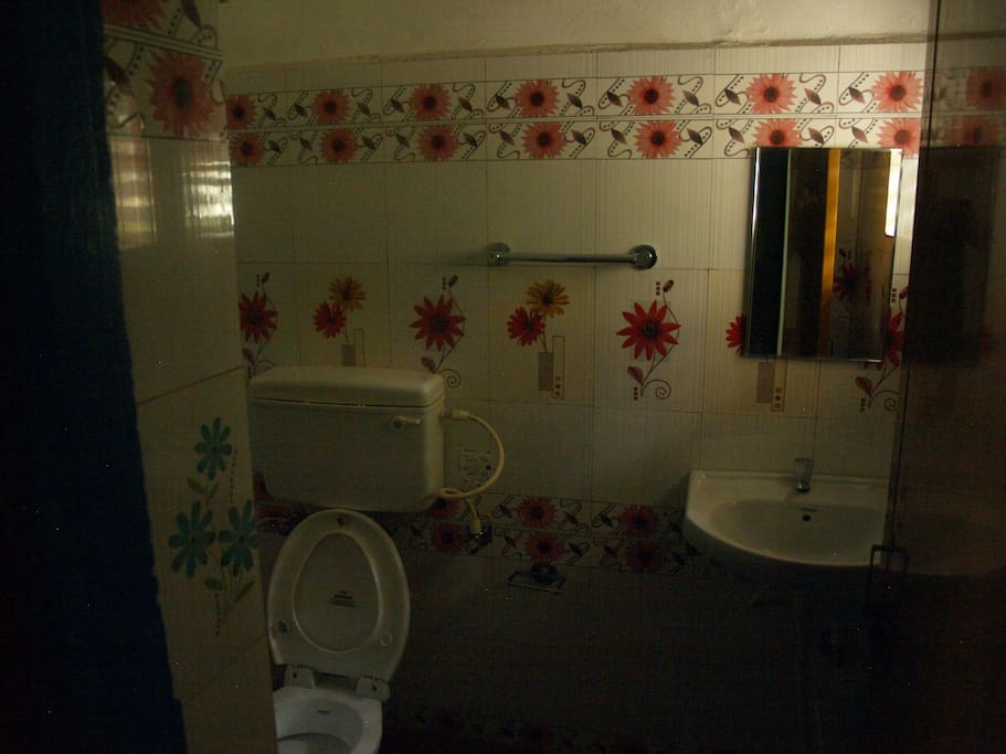 New attached Bathroom with traditional handi, copper pot water heater.
