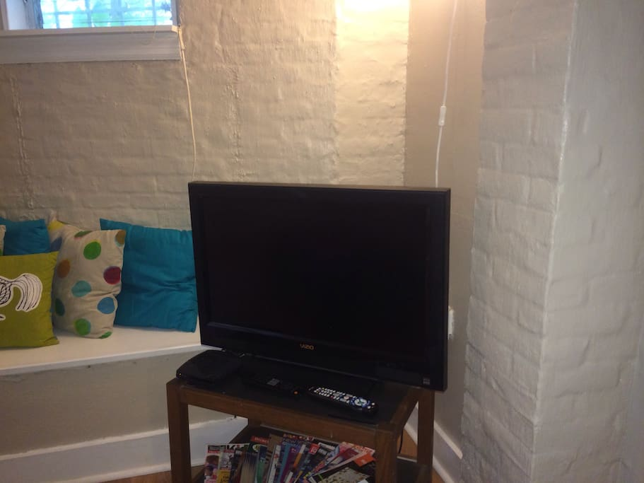 Flat screen TV with cable in living room.