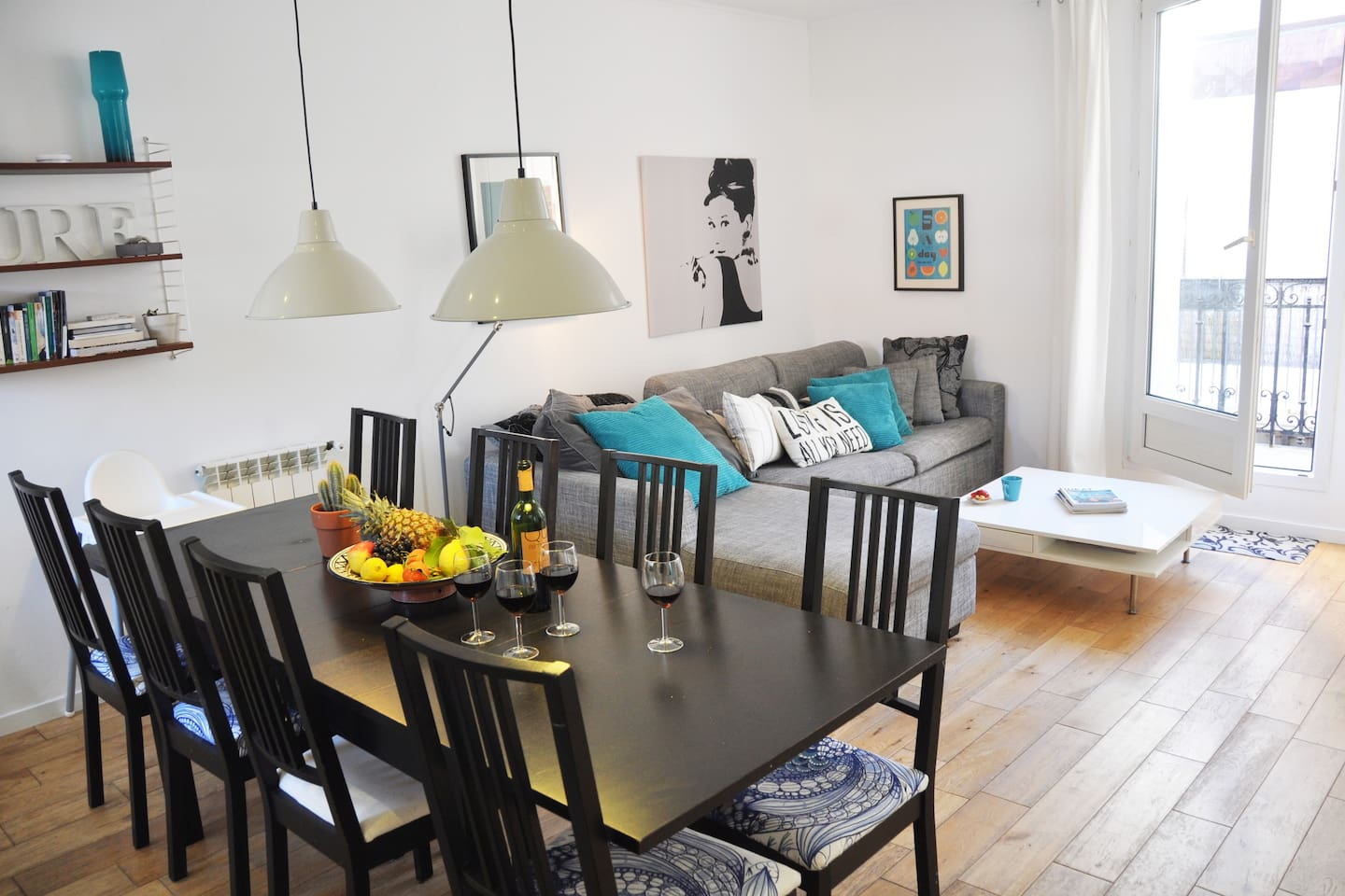 The main living room and dinner table, with access to the balcony with morning sun!
