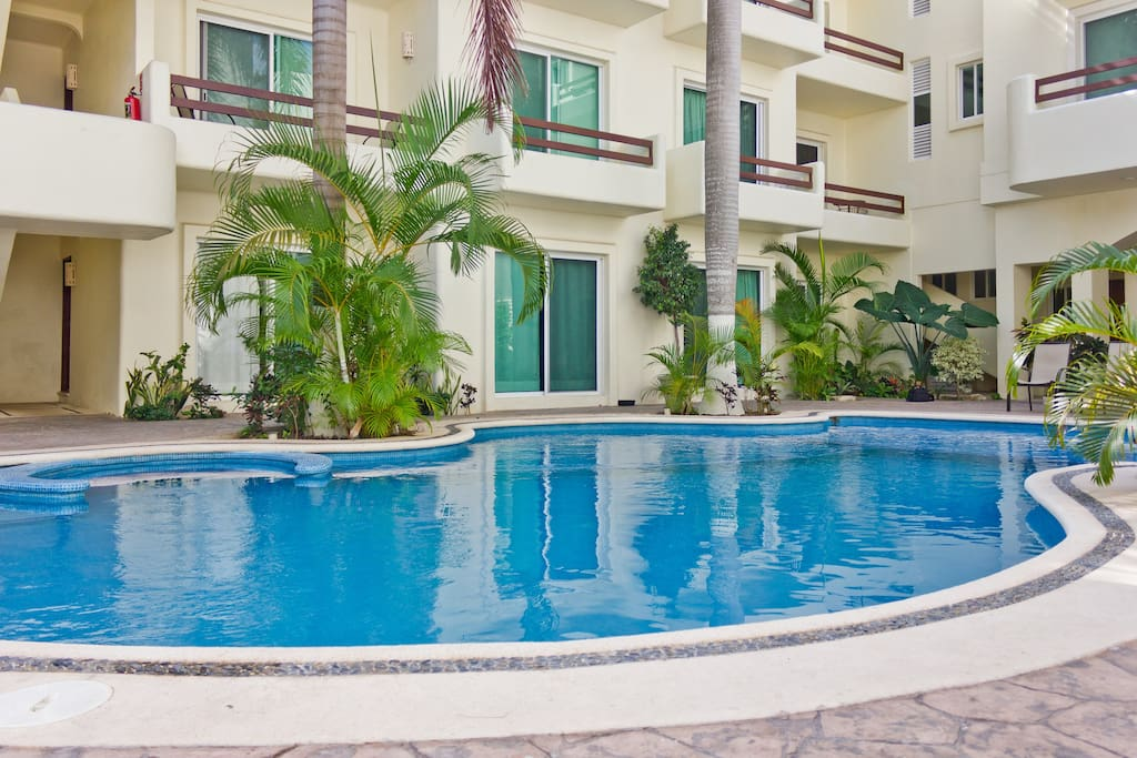 Casa Valentina's 2 balconies are in the right corner on the 1st floor, overlooking the swimming pool.