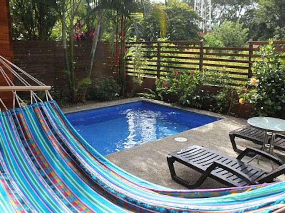 Lay on the hammock and watch the kids swim.