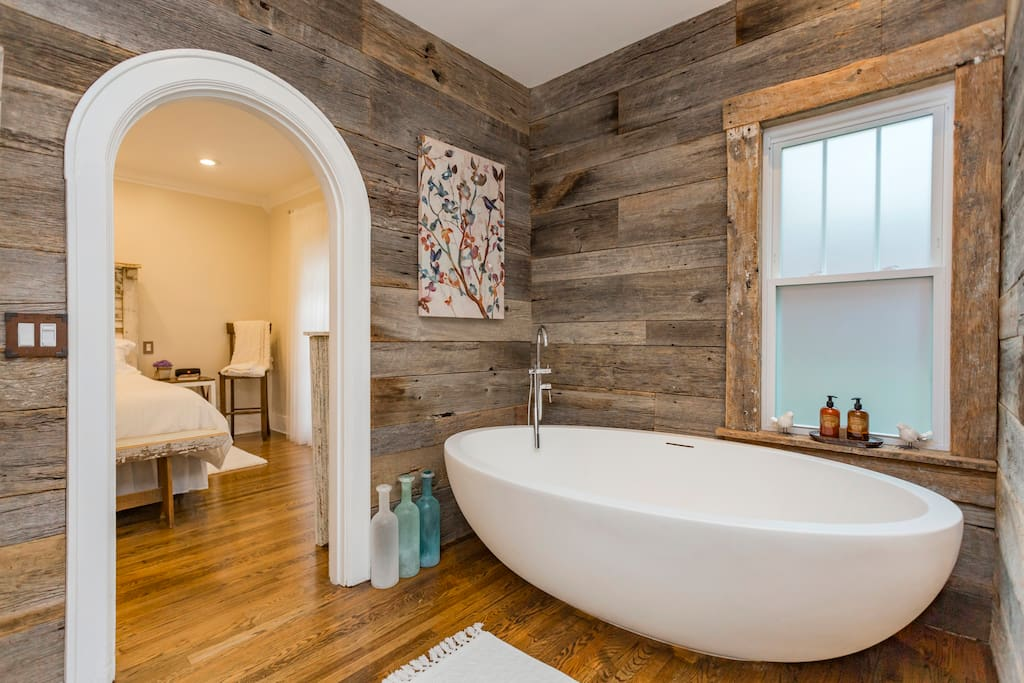 The master bath on the first floor features this enormous soaking tub big enough for two.