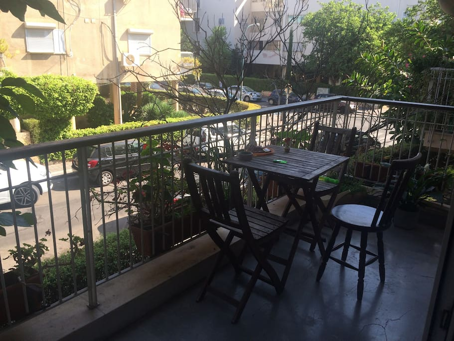 have your morning coffee at our pastoral balcony on a typical quiet Tel Aviv's street