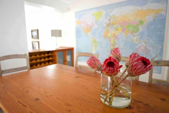 Have dinner next to the world map and plan your next trip