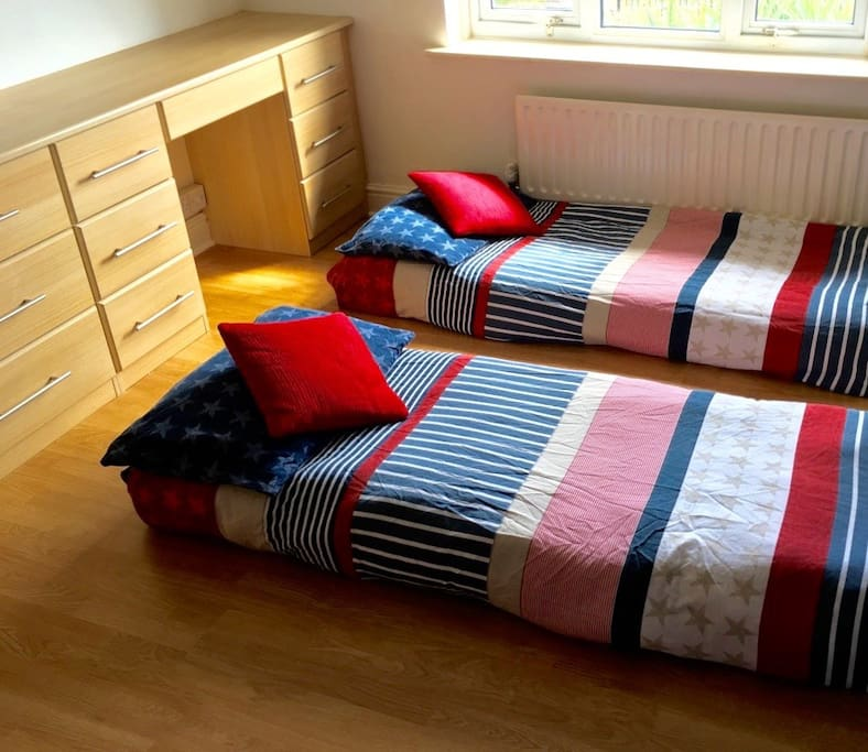 Kids bedroom with two single beds