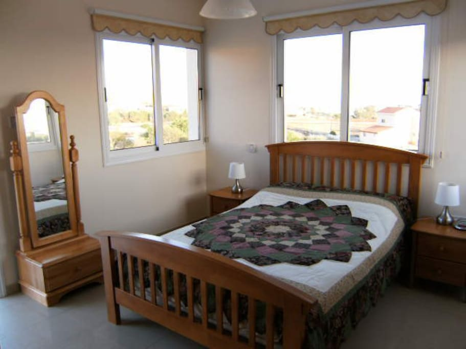 Second bedroom with sea view balcony, dressing mirror and ensuite bathroom.