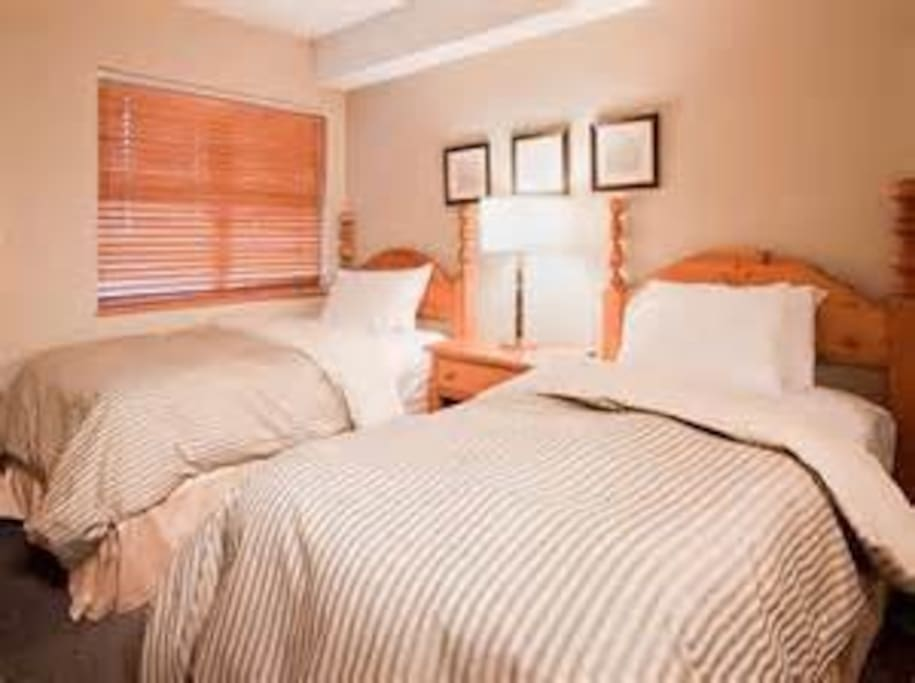 One room has twin beds the other a queen or king size bed.