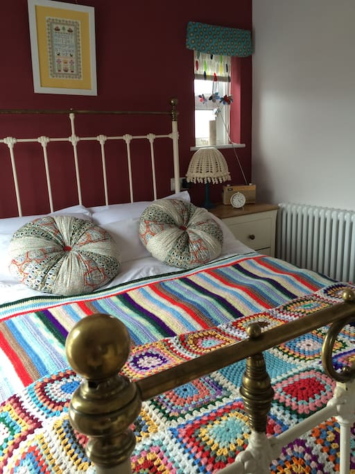 Handmade soft furnishings are features of the room.