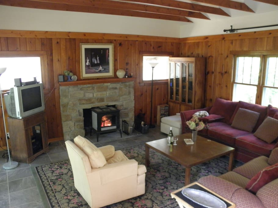 We call it the Great Room. Relax in front of the wood burning stove.