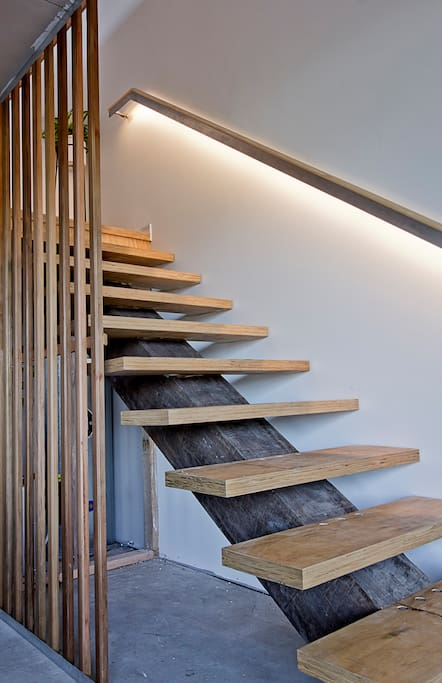 Staircase leading up to bedroom, bathroom and living area