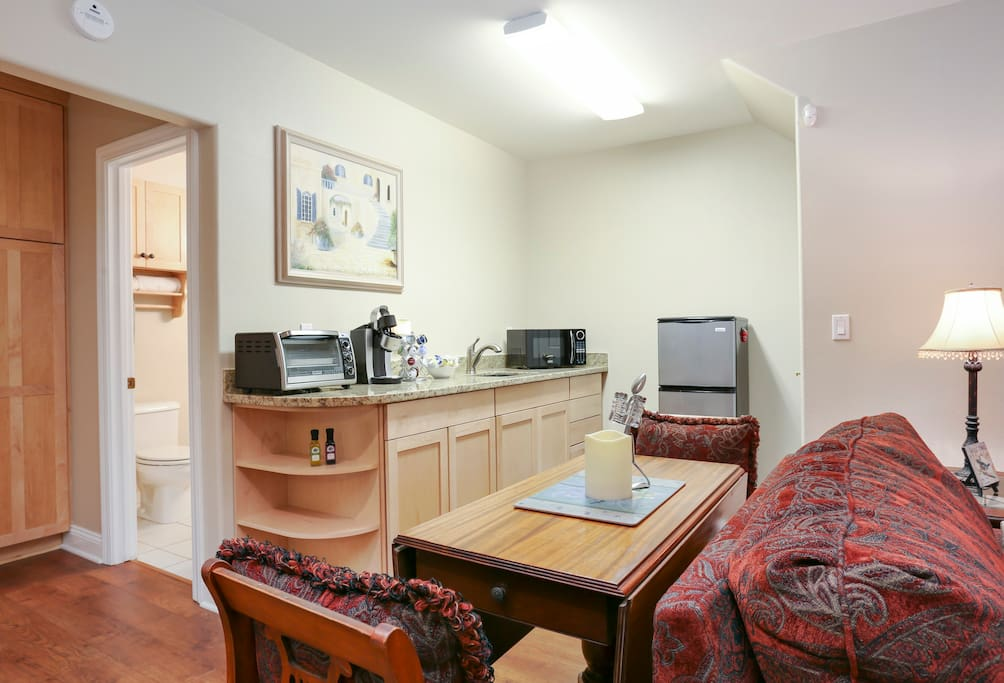 Kitchenette:  Includes refrigerator/freezer, microwave, toaster-oven, Keurig coffee maker + generous coffee & tea assortment, sink, plates, glasses, utensils, and all the comforts of home. No stove or dishwasher.