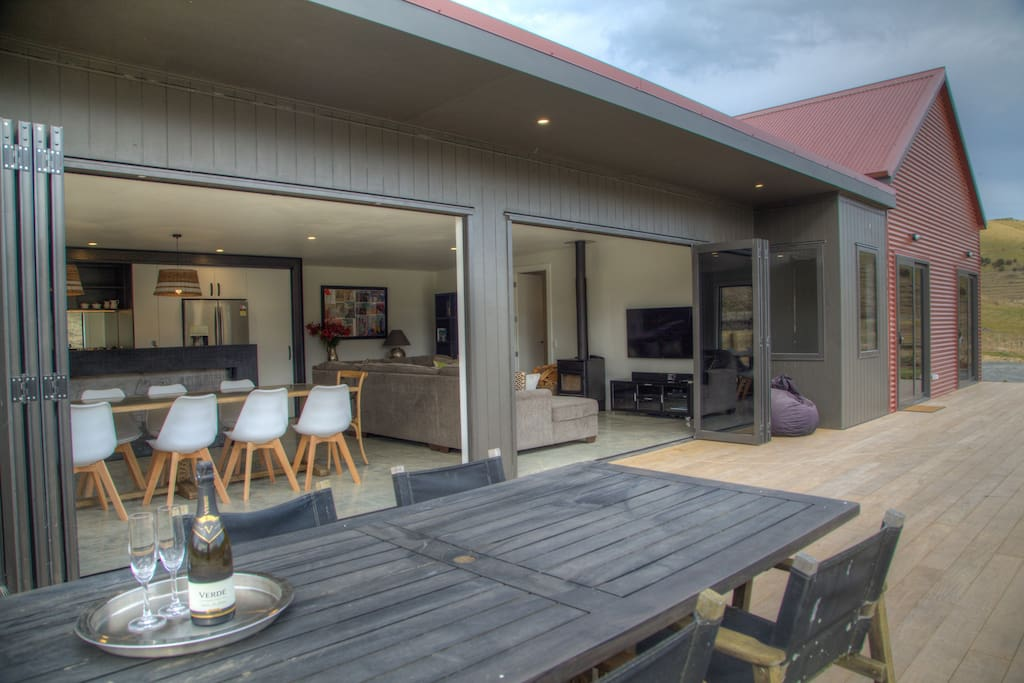 Indoor and outdoor living and dining areas