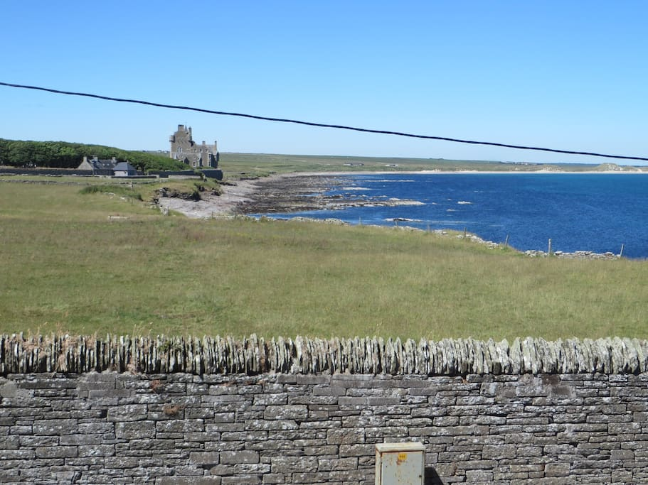 View from the master bedroom looking towards Ackergill Tower and beach.