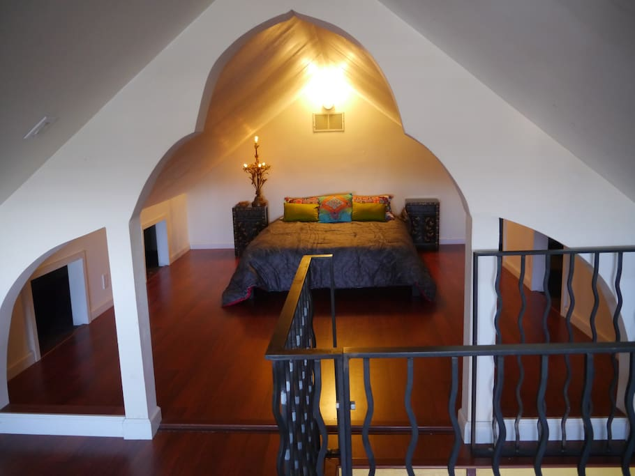 One area of the loft space with queen bed