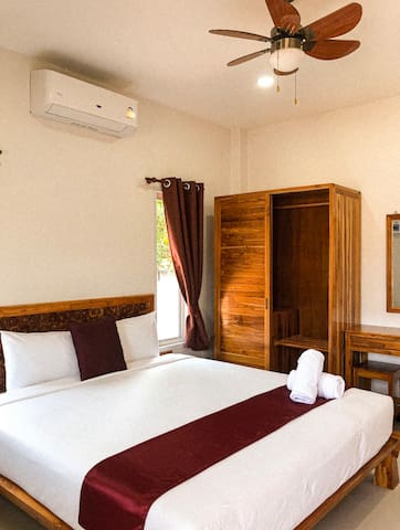 This is the picture of the bedroom with its king size bed and its sleep inducing ambience.
