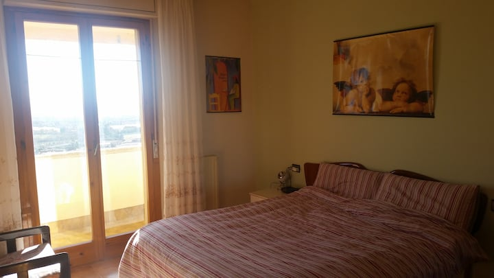 Bright room with panoramic view on Perugia