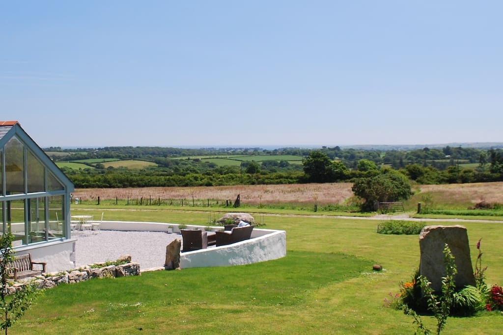 Views across the garden and attached fields to the sea in the distance