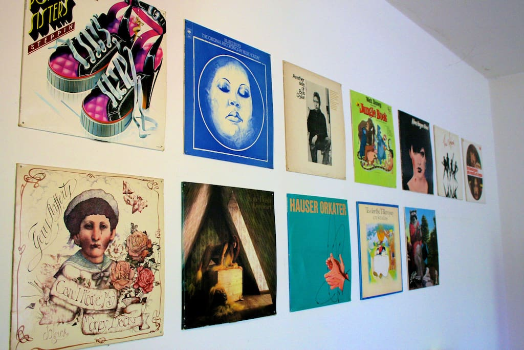 Our wall is covered with covers of old playing records, from Bob Dylan to Jungle Book..