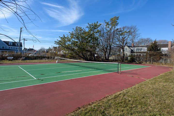 Tennis court is on west end of property.