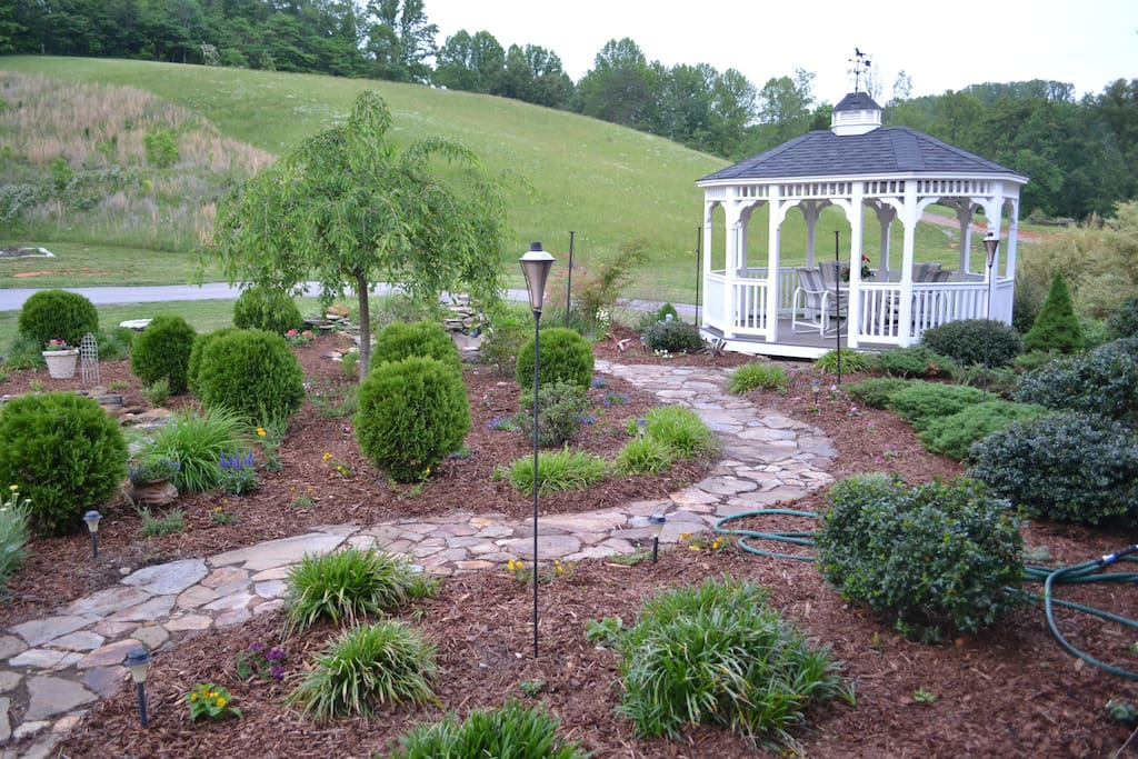 Landscaped gazebo area for relaxing.