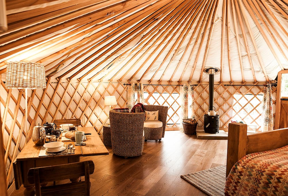 Log stove, dining and seating in the stunning Yurt