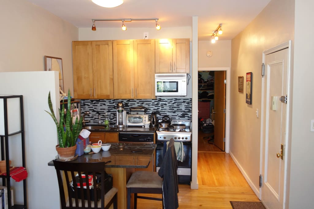 Kitchen with new appliances, dishwasher, granite countertops, stove.