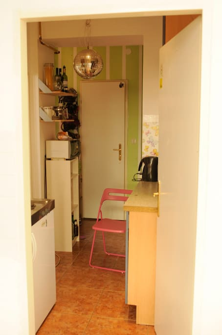 kitchen, the door you see is the toilette.