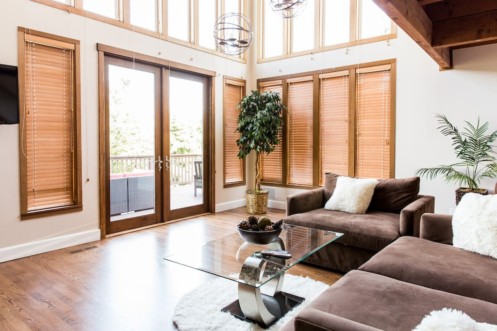 Living room with doors that open out to patio with lake view