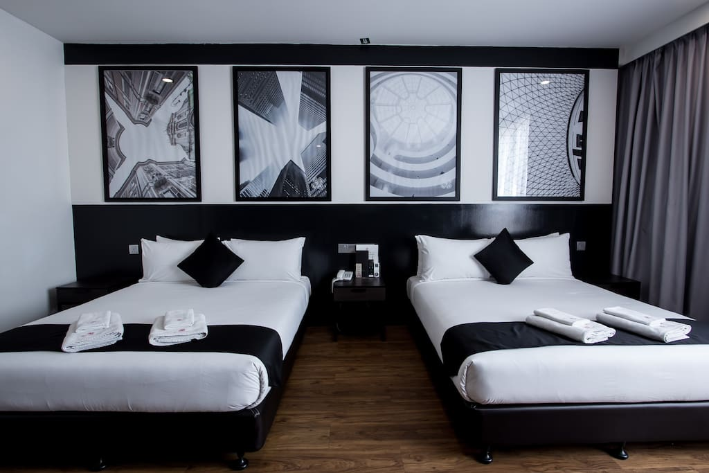 Two queen bed with high quality bed linen, duvet and pillows