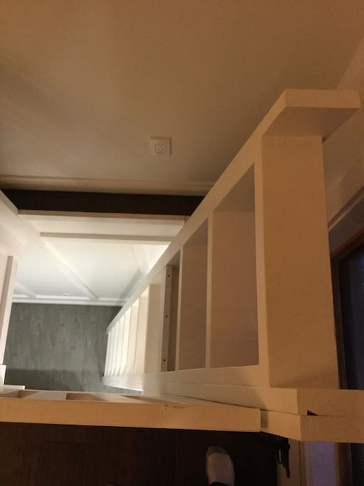 Ladder from the main floor to the bedroom. Wide steps and comfortable angle to use.
