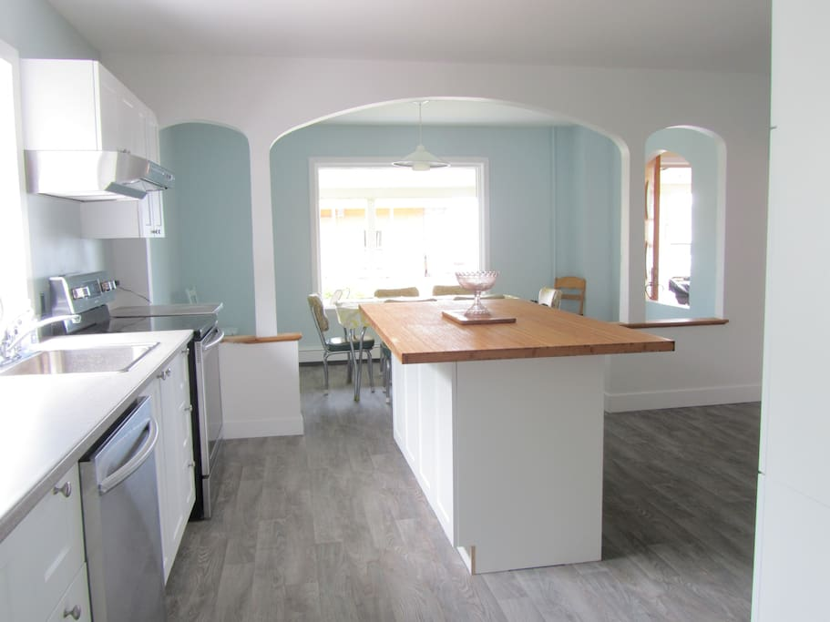 Big bright and brand new kitchen with stainless steel appliances