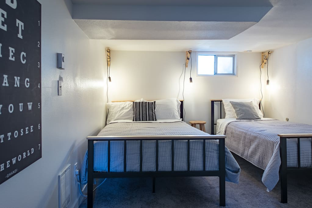 The second bedroom has both a double bed and a single, offering flexible guest accommodation.