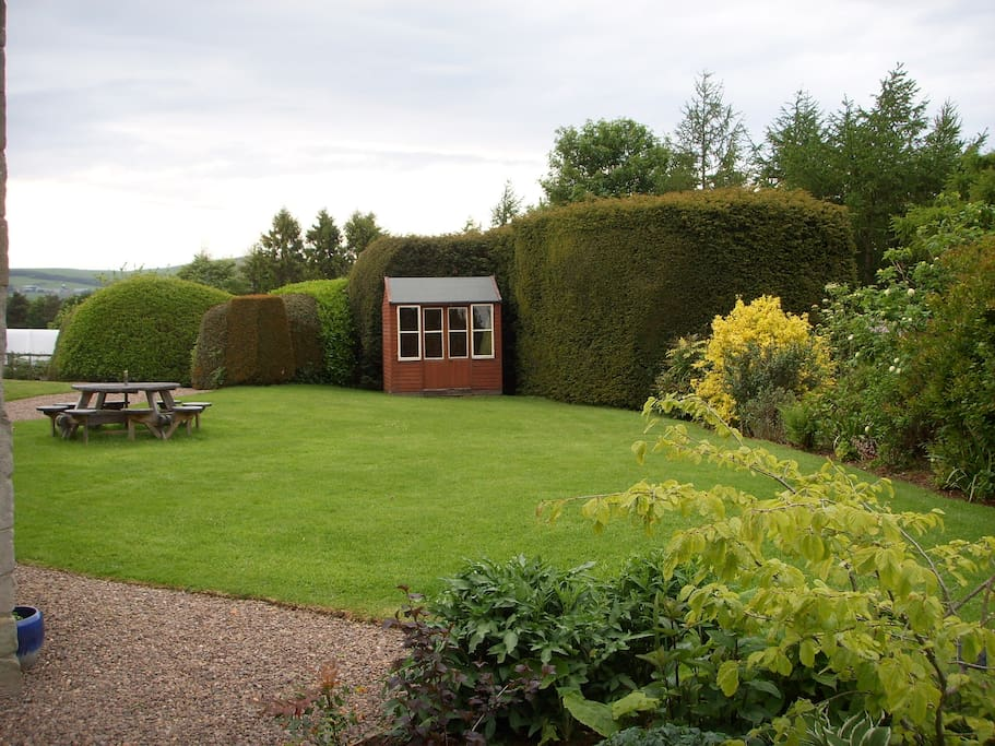 Private garden with outdoor eating for 8. BBQ and fire pit available.