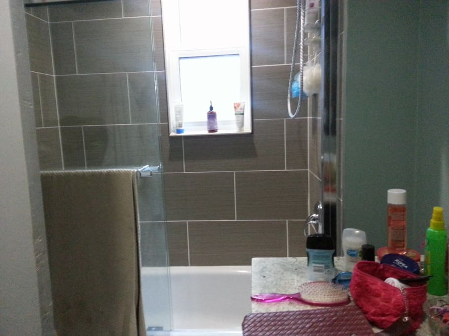 one of two full bathrooms with showers