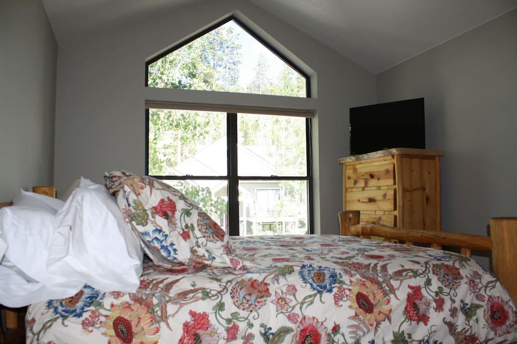 Guest bedroom with brand new queen bed