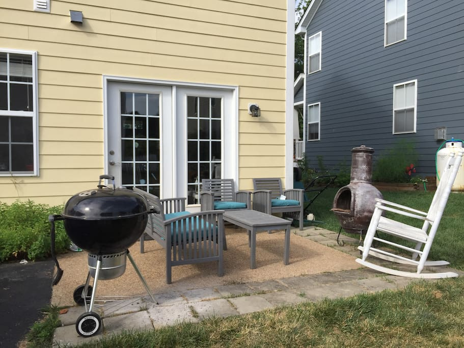 Back porch, grill and fire pit  with seating for 6