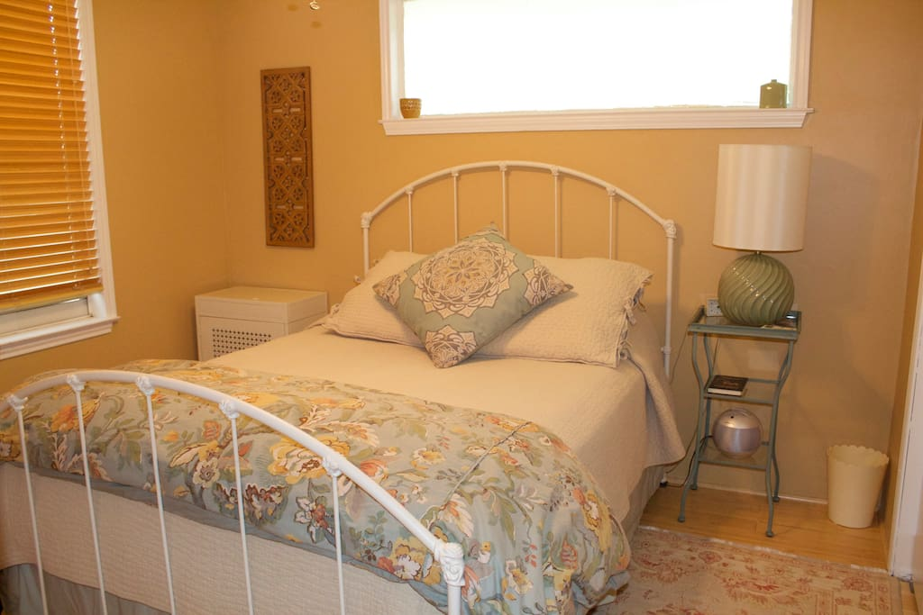 Super comfy queen size bed in a separate bedroom.