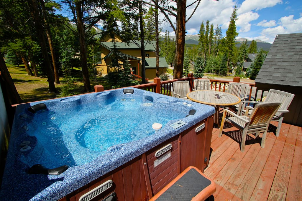Private hot tub deck in a woodsy setting near the slopes
