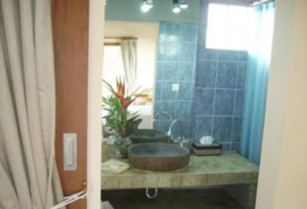 Spacious, fully appointed bathroom with hot and cold water to shower