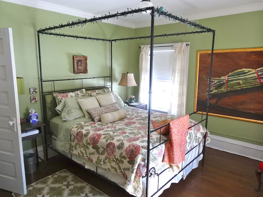 A queen size iron four poster bed is yours when you book the Asparagus Room