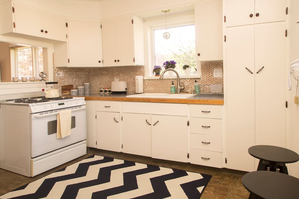 Make yourself at home in a bright modern take on an old school 1950's-era kitchen.