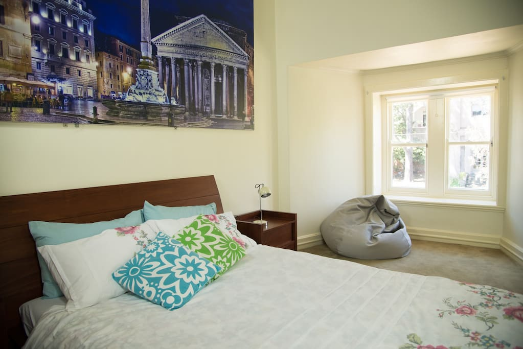 The  bedroom is over 22 square meters with a lovely view to a quiet garden
