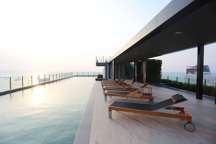 Rooftop Swimming Pool with Sunset View