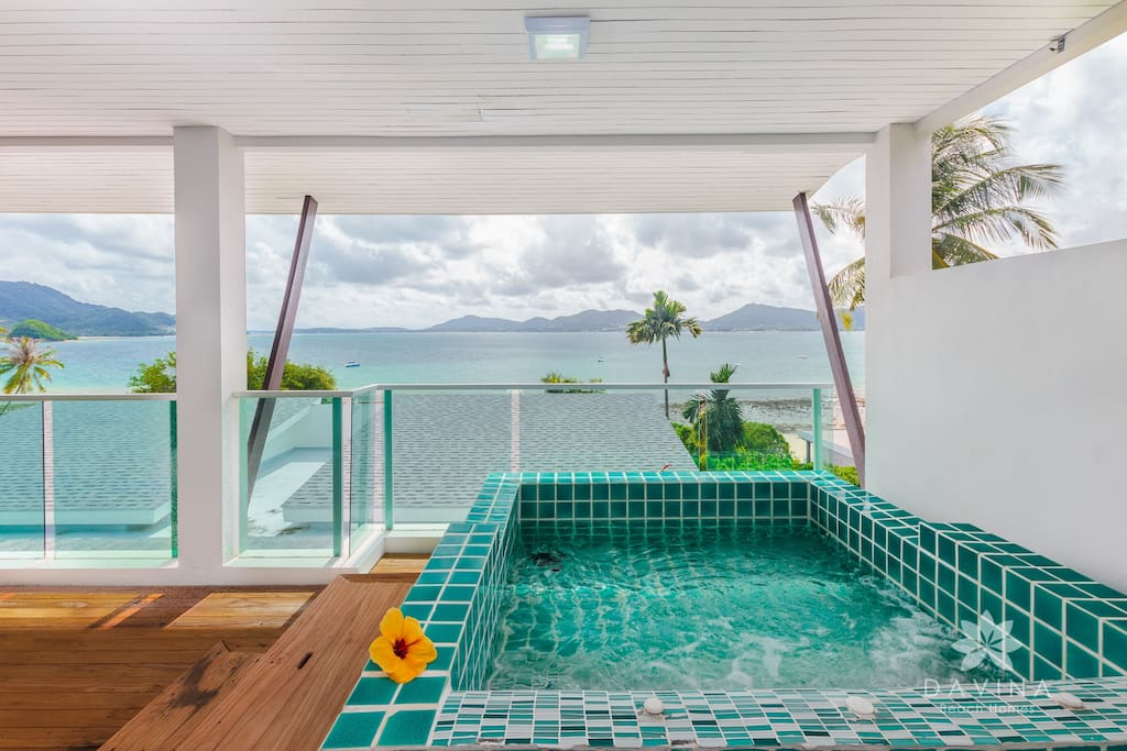 Private seaview terrace with jacuzzi (this picture is taken from room of the top building, therefore may have a slightly more extensive view of the sea than other rooms. Inquiry would have to be made on availability, if requiring this room type)