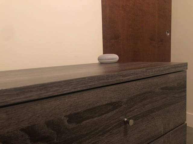 Guest room dresser and Google Home device